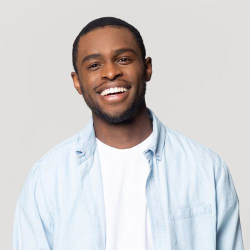 Older couple considering dental implant tooth replacement options