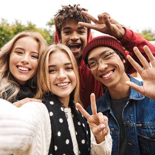 smiling teens taking a selfie together