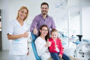 Smiling family visiting Midlothian family dentist